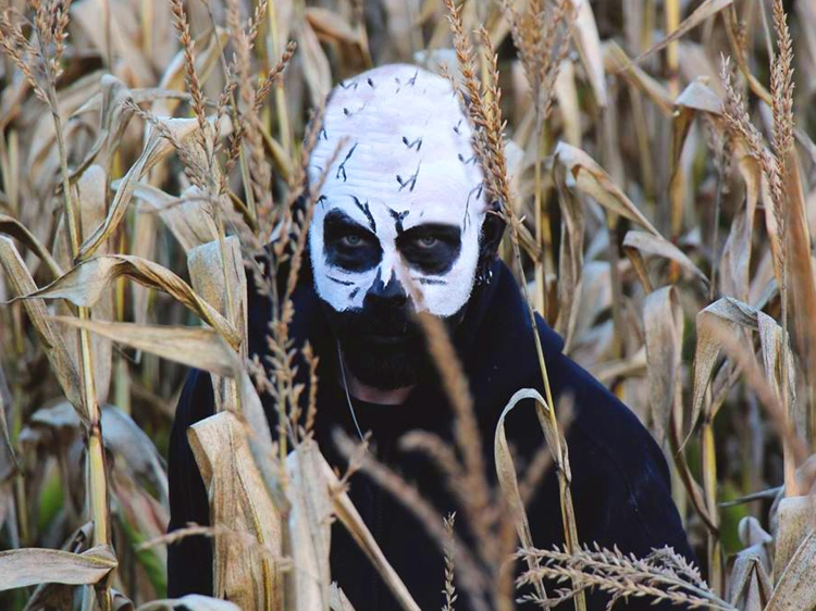 Scary man in a corn patch.