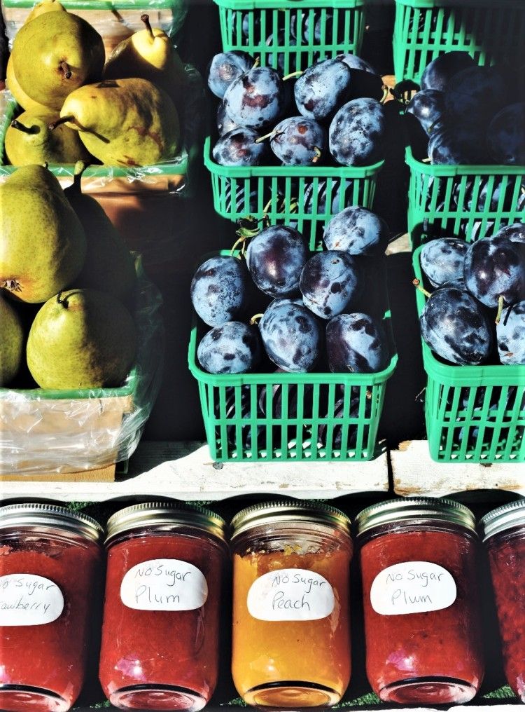 Fruit stand with fruits and jams