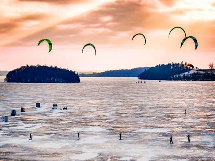 People out snow kiting on Rice Lake.