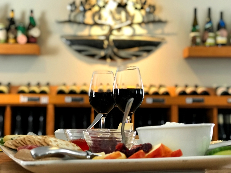 Wine and cheese at Georgian Hills Vineyard, the striking metal vineyard emblem is a custom Michael Pocock piece